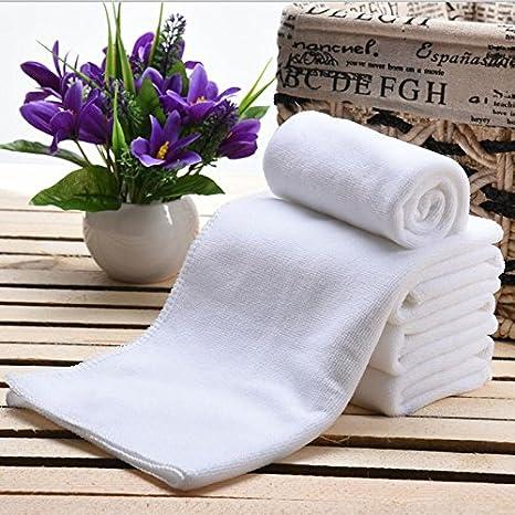 Zantec Toallas desechables blancas del salón de pelo de la toalla de cara de 10pcs Toalla del recorrido de los 30 * 70cm: Amazon.es: Hogar