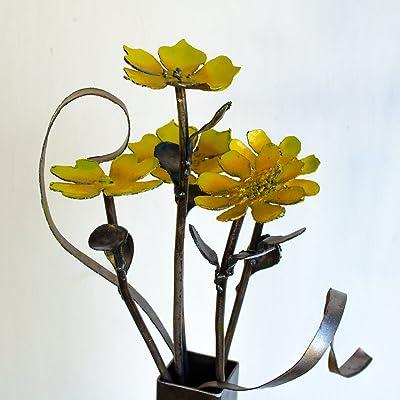 Vase of metal daisy flowers