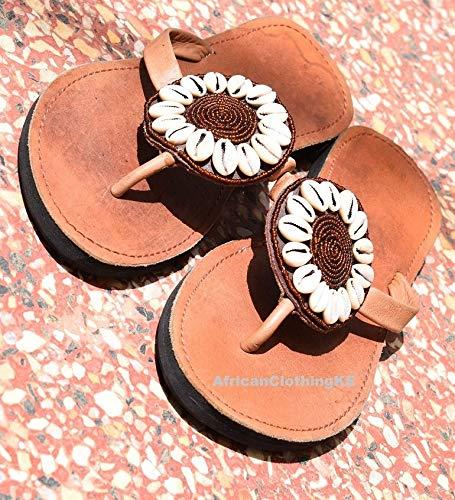 c1068a340065b Amazon.com: Sandy Reef Cowrie Sandals for Women   Handmade Leather Reef Flip  Flops for Women: Handmade