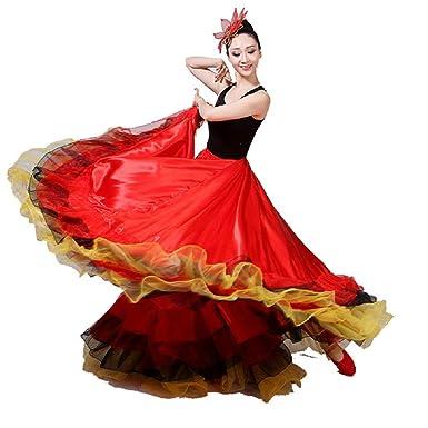 A flamenco dancer holds her skirt