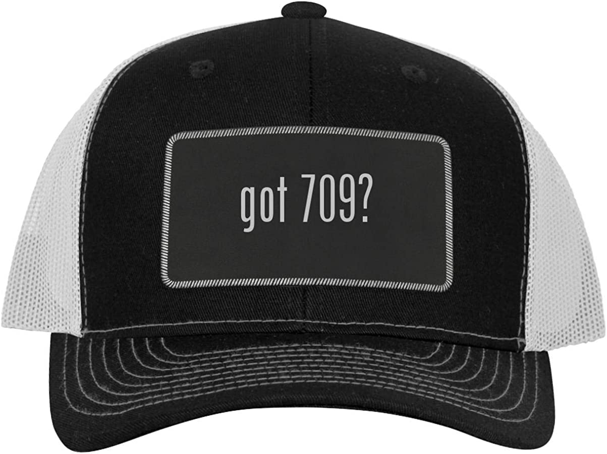 One Legging it Around got 709? - Leather Black Metallic Patch Engraved Trucker Hat