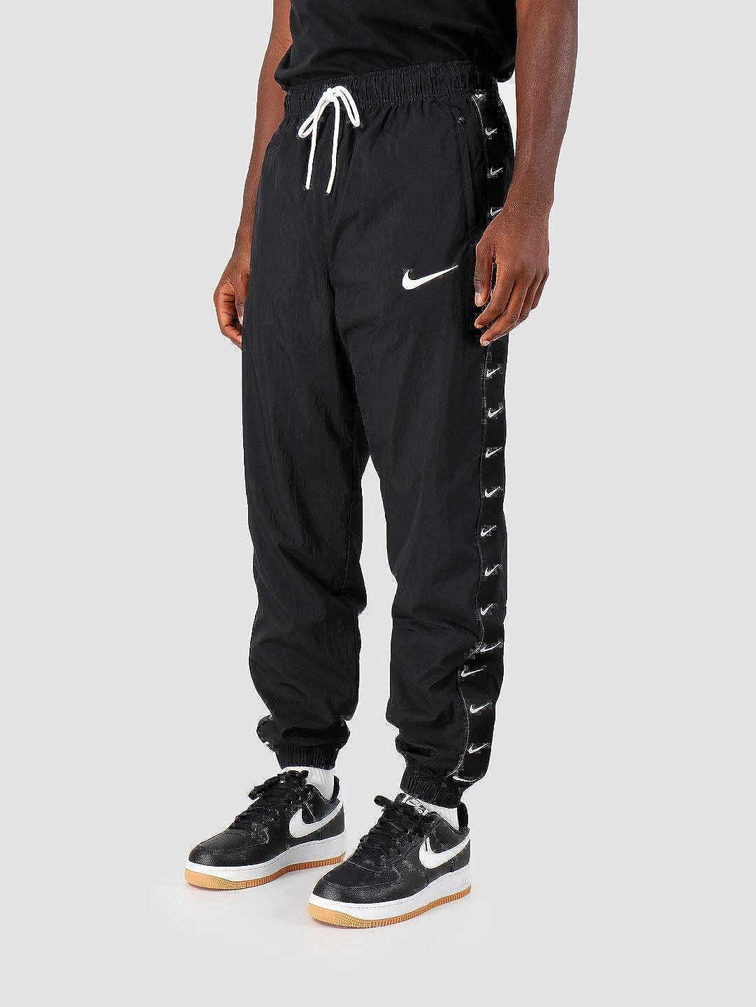 Nike Pantalones Sportwear Swoosh Woven Negro XL (X-Large): Amazon ...