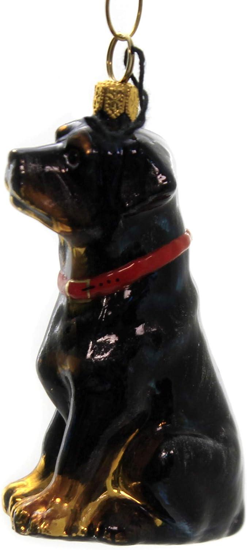Hand blown glass sitting rottweiler figurine collectible.
