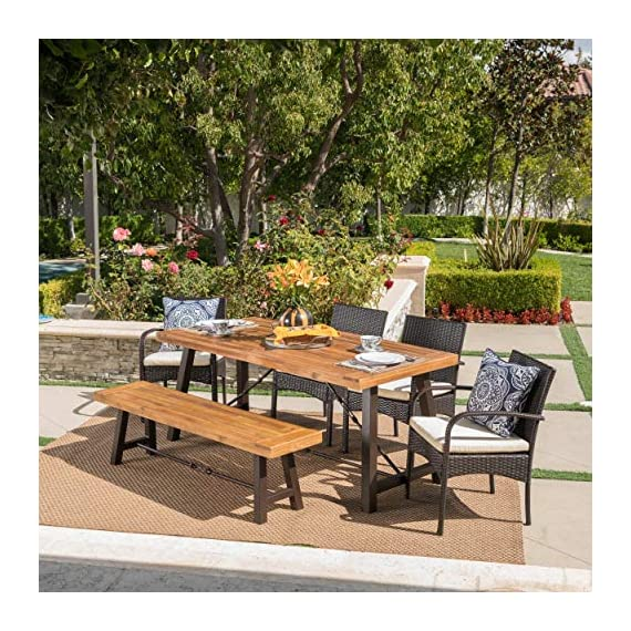 Christopher Knight Home Betsys Outdoor Acacia Wood Dining Set with Wicker Dining Chairs and Water Resistant Cushions, 6-Pcs Set, Teak Finish / Rustic Metal /  Multibrown / Crème - This clean and simple Dining set combines the functionality of wood and iron with the comfort of wicker. Complete with a Table, bench, and 4 wicker dining chairs, this set offers comfortable seating for 6 in the great outdoors. Sure to complement any patio décor, This Dining set offers you a stylish wooden design with the functionality of an iron framework and comfortable Wicker chairs,  to give you a weather resistant Set that will last your for years to come. Includes: one (1) Table, one (1) Bench, and four (4) chairs Table and bench material: Acacia wood table and bench frame material: Metal chair Material: Polyethylene wicker chair cushion material: Water resistant fabric composition: 100% polyester chair frame material: iron Table and bench finish: teak table and bench frame finish: rustic metal wicker finish: Multibrown cushion color: crème assembly required Hand crafted details Table dimensions: 33. 00 inches deep x 70. 00 inches wide x 29. 50 inches high bench Dimensions: 14. 50 inches deep x 63. 00 inches wide x 17. 75 inches high Seat width: 14. 57 inches Seat Depth: 63. 00 inches Seat Height: 17. 72 inches Chair dimensions: 23. 50 inches deep x 22. 10 inches wide x 32. 75 inches high Seat width: 18. 25 inches Seat Depth: 18. 25 inches Seat Height: 16. 50 inches Arm Height: 24. 60 inches - patio-furniture, dining-sets-patio-funiture, patio - 61luEviQMCL. SS570  -