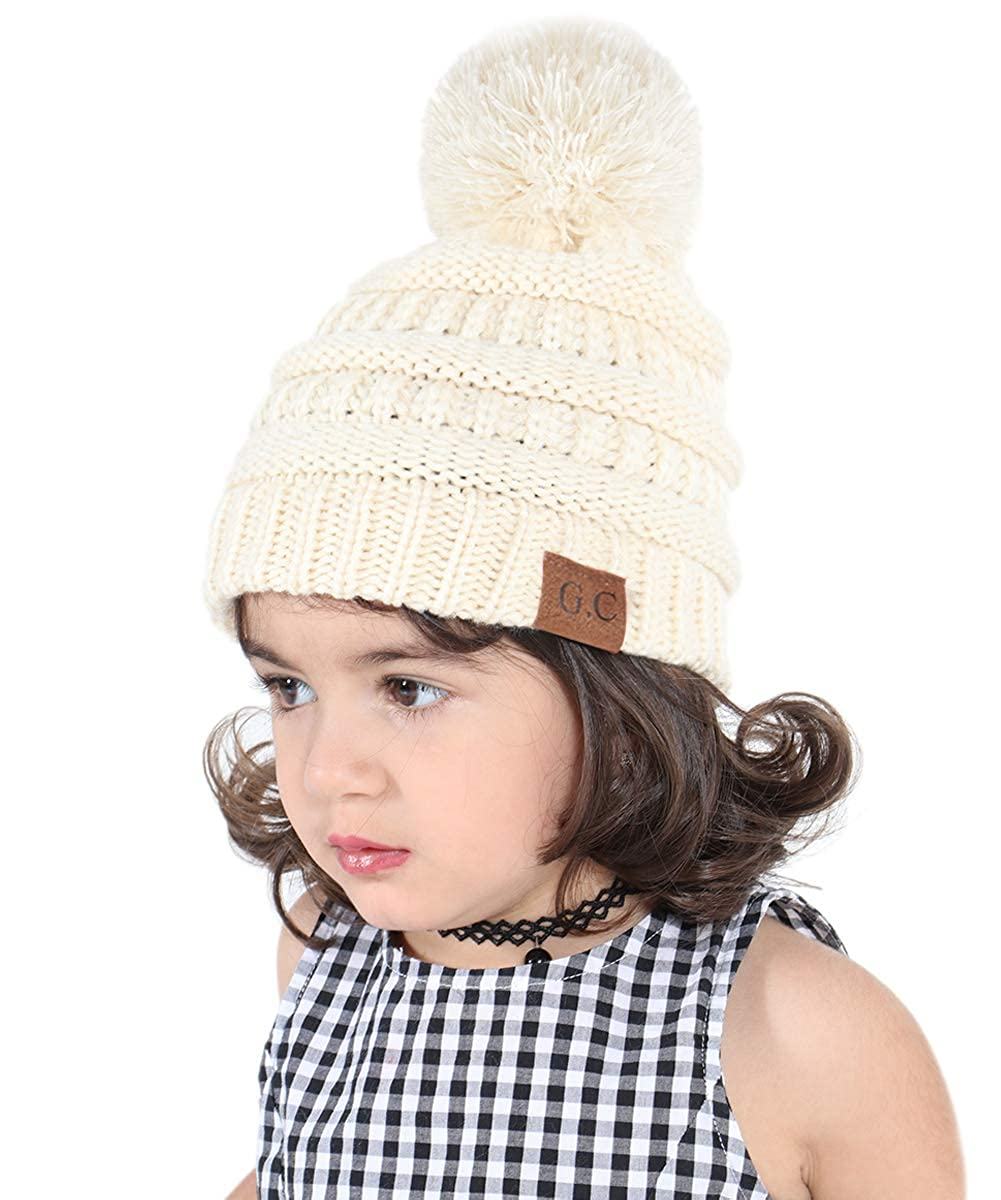 Amazon.com  Dissytoys Kids Winter Pom Hat Cable Knitted Beanie Cap for  Toddlers Boys Girls Ages 2-8 (Beige)  Clothing 19339dc4bd6