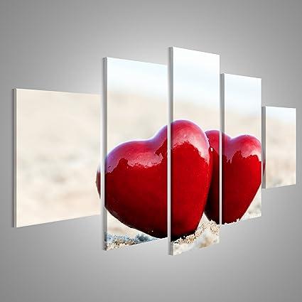 Quadro moderno Due cuori rossi sulla spiaggia che simboleggia l ...