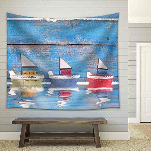 Shabby Toy Boats in a Row on a Wooden Blue Background Concept for Cruising Sailing Holiday Fabric Wall Tapestry