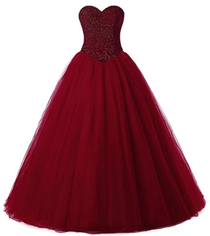 5869a6621 Este vestido color borgoña está elaborado con material de tul y cosido con  detalles en satén. Tiene un corte de novia con adornos de abalorios y  lentejuelas ...