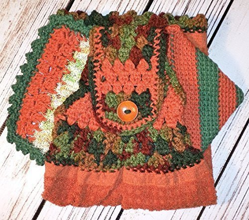 A handcrafted kitchen set that is sure to please anyone on your holiday listl One of a kind gifts that can be used all year. Contemporary fall colors crocheted kitchen set.