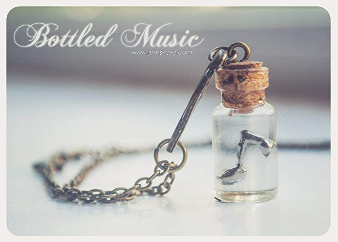 Collar de botella de música embotellado. collar de frasco de vidrio con nota de la