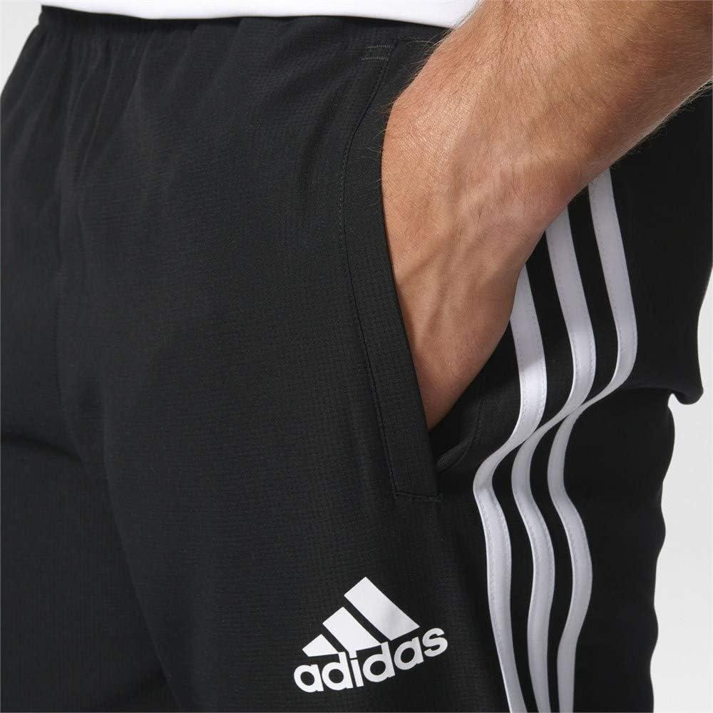 adidas Tango Cage Woven Pantalón, Hombre: Amazon.es: Ropa y accesorios