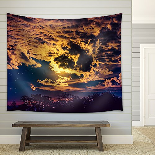 Attractive of Amazing Gold Dark Night Sky with Many Stars and Cloudy Above Silhouette of Trees Fabric Wall