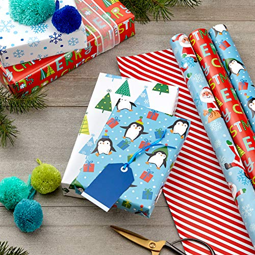 Hallmark Cute Reversible Christmas Wrapping Paper for Kids (3 Rolls: 120 sq. ft. ttl) Penguins, Santa, Trees, Stripes…