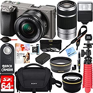 Sony Alpha a6000 24.3MP Interchangeable Camera 16-50mm & 55-210mm Zoom Lens (Grey)+ 64GB Accessory Bundle + Deluxe Gadget Bag + Extra Battery+Wide Angle Lens+2x Telephoto Lens +Flash +Remote +Tripod