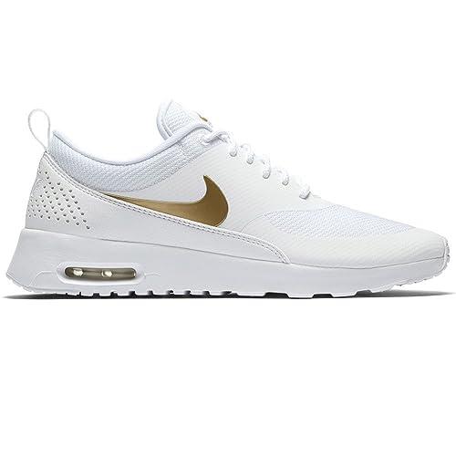 save off c63d3 3074d Nike Wmns Air MAX Thea J, Zapatillas de Gimnasia para Mujer, Blanco Mtlc  Gold/White 100, 36 EU: Amazon.es: Zapatos y complementos