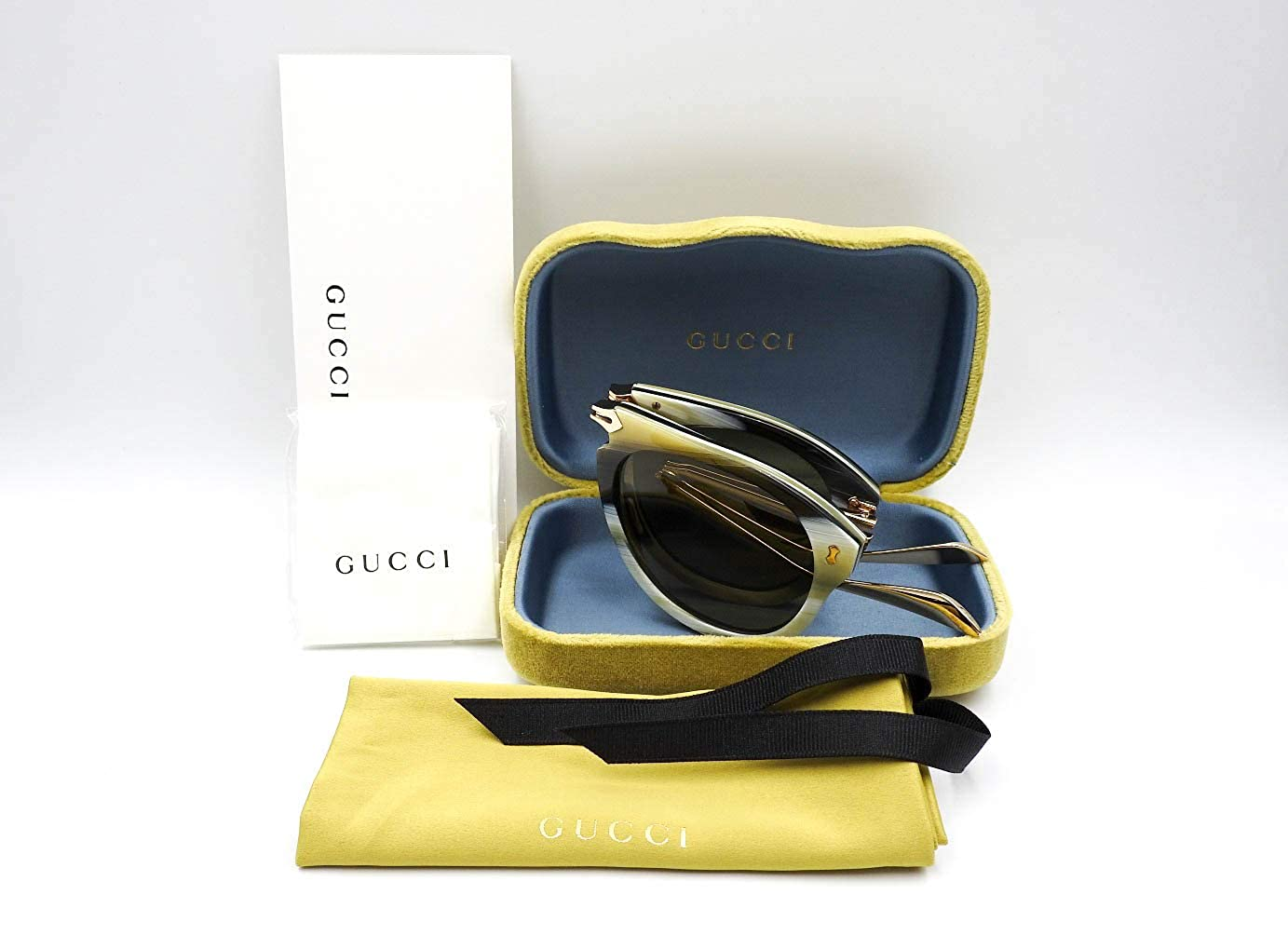 6b79b302b7eab Amazon.com  Gucci GG0305S 003 Foldable Beige Striated Plastic Aviator  Sunglasses Green Lens  Clothing