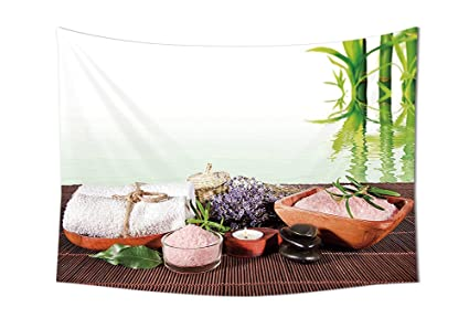Spa Decor tapiz bambú toalla de fondo con flores vela y Zen caliente piedras de masaje