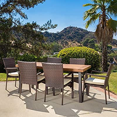 "Christopher Knight Home Castlelake | 7 Piece Outdoor Dining Set with Cushions | Perfect for Patio | in Brown - Includes: One (1) Table and Six (6) Chairs Table Material: Acacia Wood | Chair Material: Faux Wicker | Chair Frame Material: Iron | Chair Color: Brown | Chair Cushion Color: Creme Table Dimensions: 32.25 inches deep x 69.00 inches wide x 29.50 inches high Chair Dimensions: 26.00 inches deep x 22.25 inches wide x 35.00 inches high Seat Width: 18.50 inches Seat Depth: 18.00 inches Seat Height: 16.00 inches Arm Height: 26.00 inches"" - patio-furniture, dining-sets-patio-funiture, patio - 61nB2ALGDLL. SS400  -"