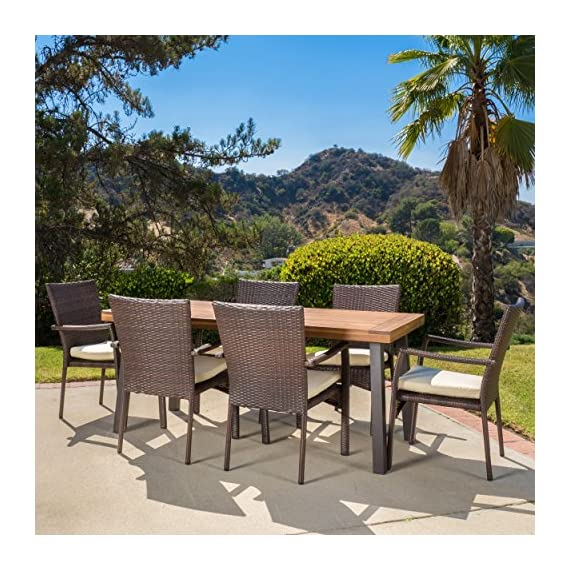 "Christopher Knight Home Castlelake | 7 Piece Outdoor Dining Set with Cushions | Perfect for Patio | in Brown - Includes: One (1) Table and Six (6) Chairs Table Material: Acacia Wood | Chair Material: Faux Wicker | Chair Frame Material: Iron | Chair Color: Brown | Chair Cushion Color: Creme Table Dimensions: 32.25 inches deep x 69.00 inches wide x 29.50 inches high Chair Dimensions: 26.00 inches deep x 22.25 inches wide x 35.00 inches high Seat Width: 18.50 inches Seat Depth: 18.00 inches Seat Height: 16.00 inches Arm Height: 26.00 inches"" - patio-furniture, dining-sets-patio-funiture, patio - 61nB2ALGDLL. SS570  -"