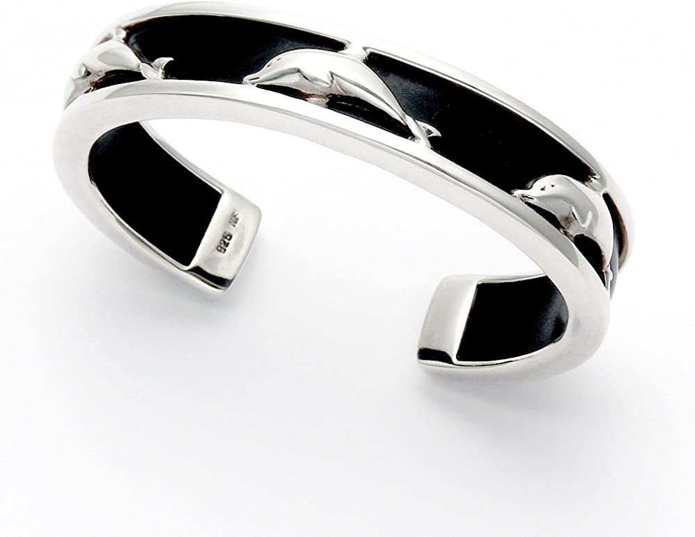 Wild Things Sterling Silver Cutout Dolphins on Black Rubber Background Bangle
