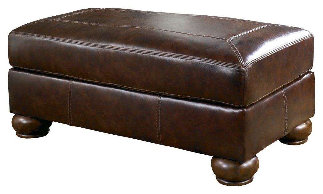 Ashley Furniture Signature Design - Axiom Casual Leather Ottoman - Walnut Brown