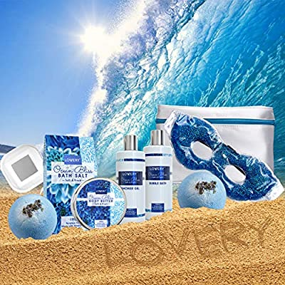 Valentine Bath and Body Gift Basket for Women – Ocean Bliss Home Spa Set with a Glittery Reusable Hot and Cold Eye Mask, Body Lotion, 2 Ex-Large Bath Bombs – 6oz, Silver Travel Cosmetics Bag and More