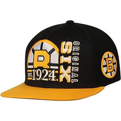 Amazon.com   Boston Bruins CCM Original Six Flat Brim Snapback Hat ... 49f2c0552ea7
