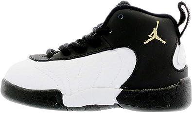 white and gold jumpman jordans