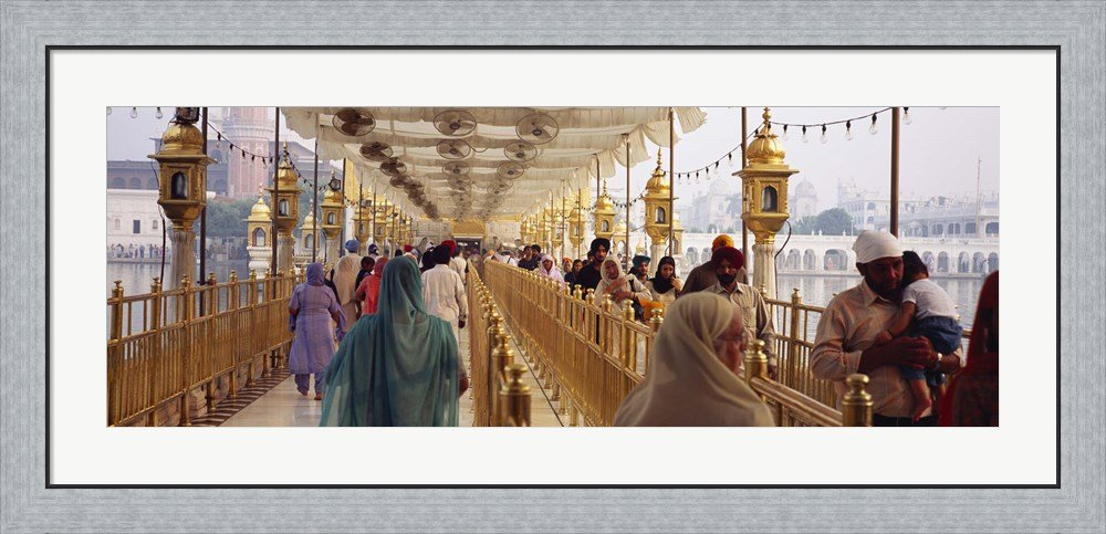 Group of people walking on a bridge over a pond, Golden Temple, Amritsar, Punjab, India by Panoramic Images Framed Art Print Wall Picture, Flat Silver Frame, 44 x 20 inches