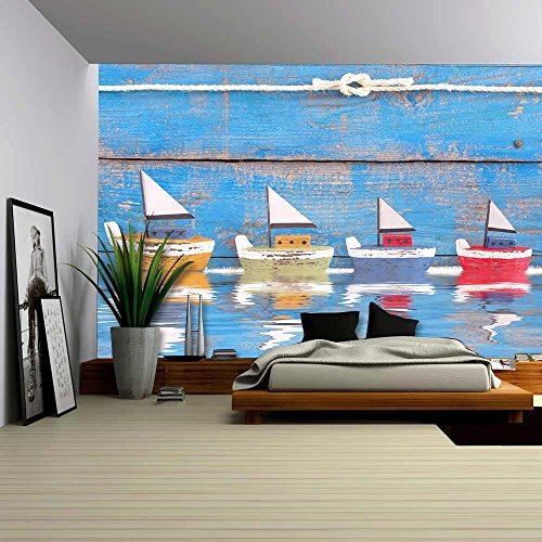 Shabby Toy Boats in a Row on a Wooden Blue Background Concept for Cruising Sailing Holiday