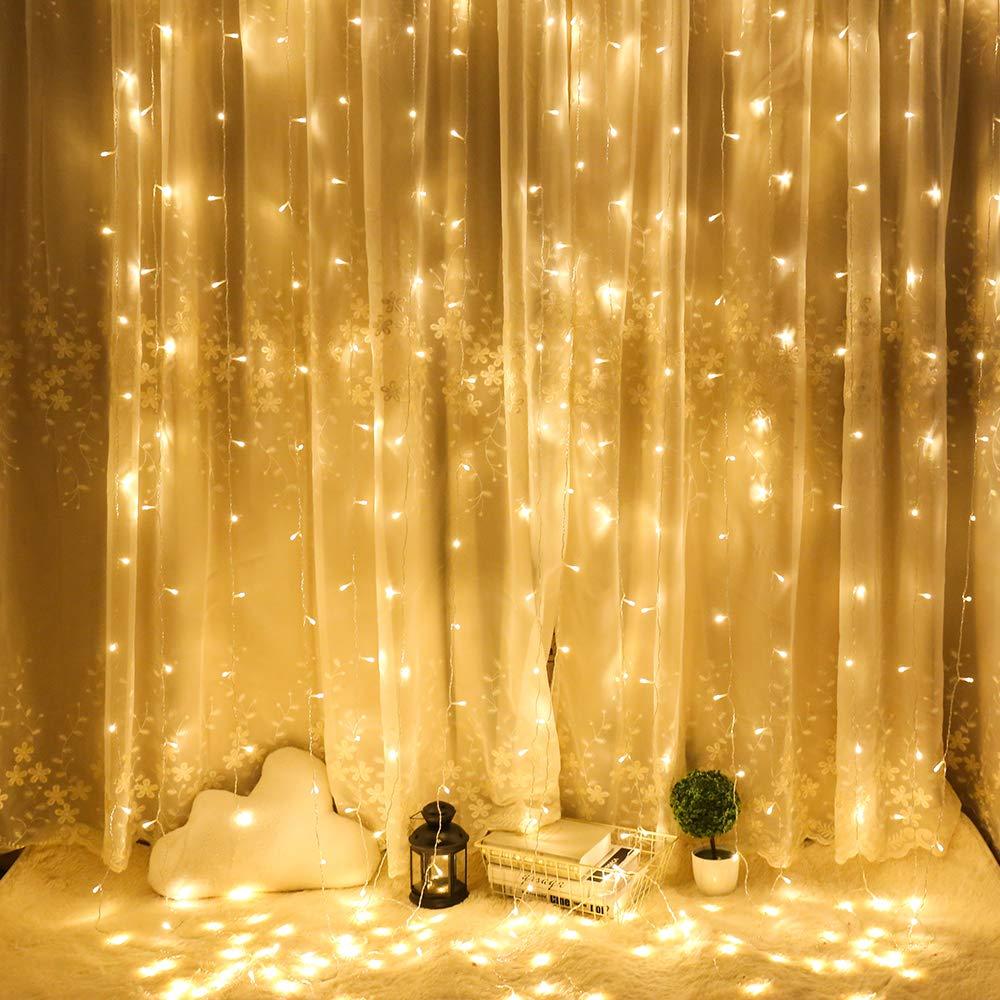 Cortina de Luces LED,AGM 3 * 3M 300LEDs Luces de Navidad al Aire Libre con 8 Modelos de lluminación para Decoración de Ventana, Patio, Jardín,Bar, Navidad, Día de San Valentín, Boda,etc(Blanco cálido) [Clase de eficiencia energética A+] Fltness
