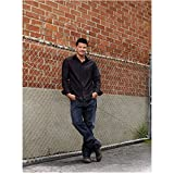 Bones David Boreanaz as Special Agent Seeley Booth Leaning Against Fence Brick Background 8 x 10 inch photo