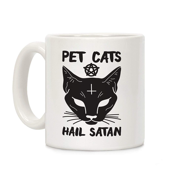 Los Gatos del Animal doméstico granizan la Taza de café de ...