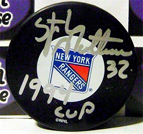 Stephane Matteau autographed puck (New York Rangers Hockey Player) inscribed 94 Cup with display cube AW Certificate of Authenticity Hologram (Cup Hologram)