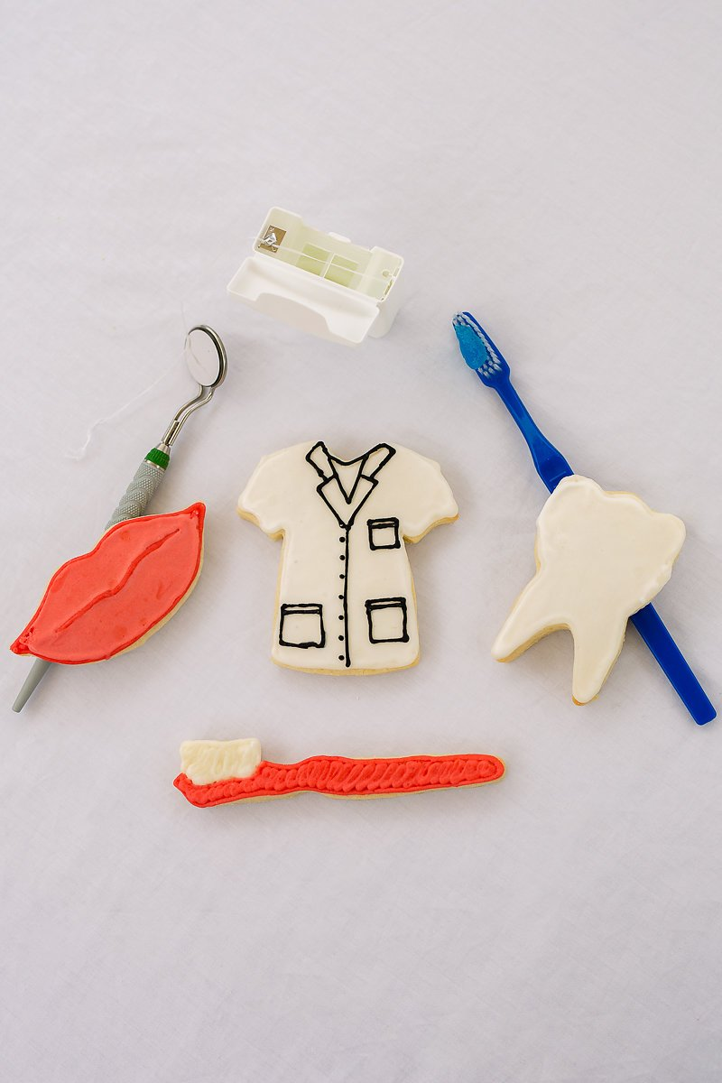 "R&M International 2002 Dental Cookie Cutters, Scrub Shirt, Lips, Tooth, Toothbrush, 4-Piece Set 4 Set of 4 tinplated steel dental themed/shaped cookie cutters Includes: 3.5"" Scrubs Tee Shirt, 3.5"" Lips, 2.5"" Tooth, and 5"" Toothbrush High-quality cutters cut through a variety of doughs easily and can also be used on sandwiches, fondant or craft clay - don't limit your imagination!"