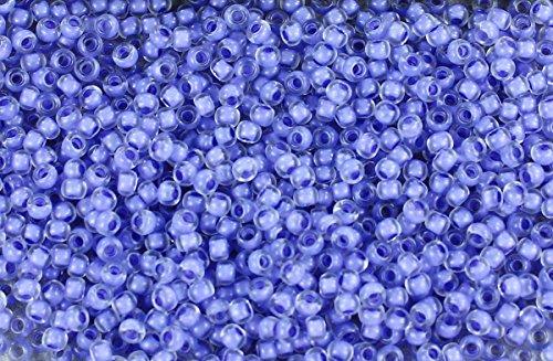 11/0 Round TOHO Japanese Glass Seed Beads #977-Crystal/Neon Purple Lined ()