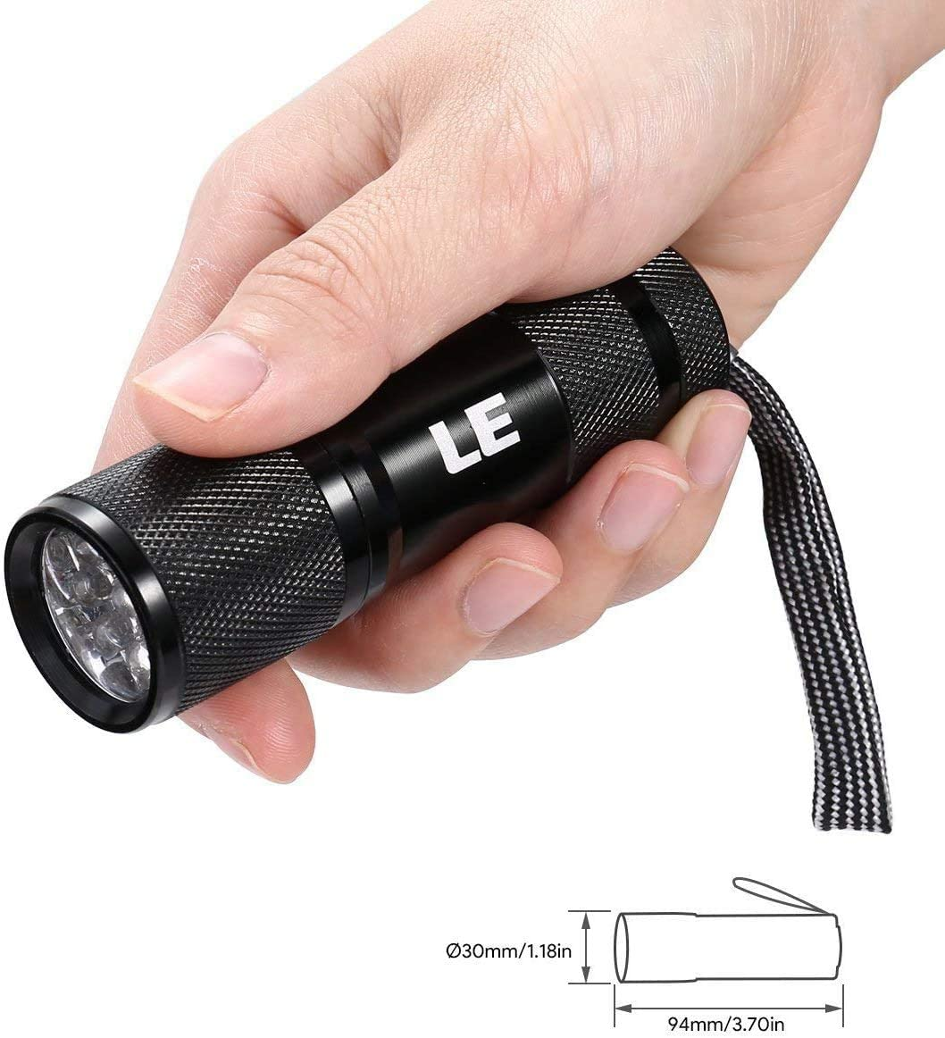 Image of a hand holding a UV flashlight, color black.