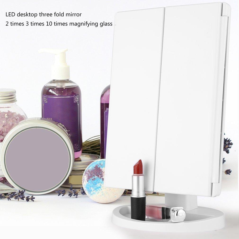 Miroir Maquillage LED lumineux, Miroir Triple Pliable avec Écran Tactile Grossissement 1X/2X/3X/10X Miroir Cosmétique 180° Ajustable avec Bouton, Câble USB pour Maquillage Beauté