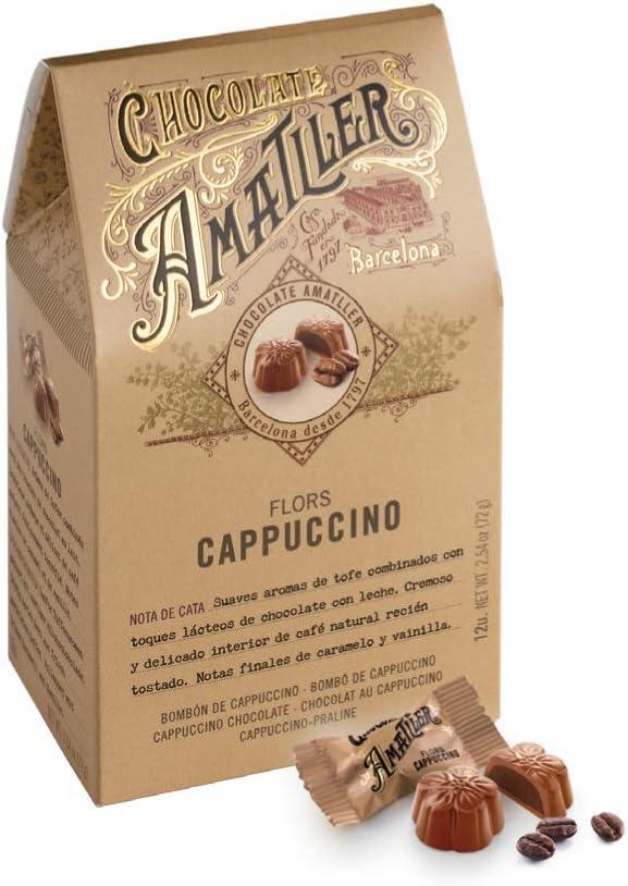 Bombones recubiertos de chocolate con leche y rellenos de ...