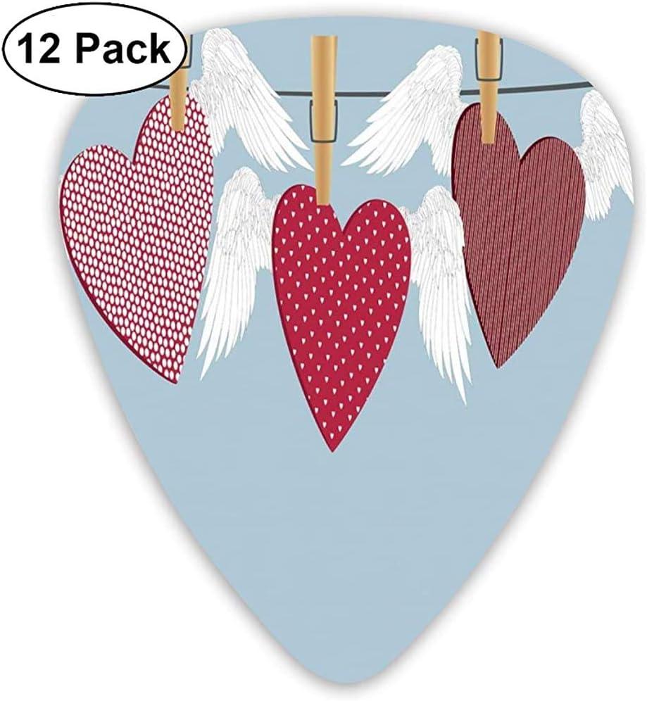 Púas de guitarra, paquete de 12, corazones con alas y diferentes patrones colgando de una cuerda
