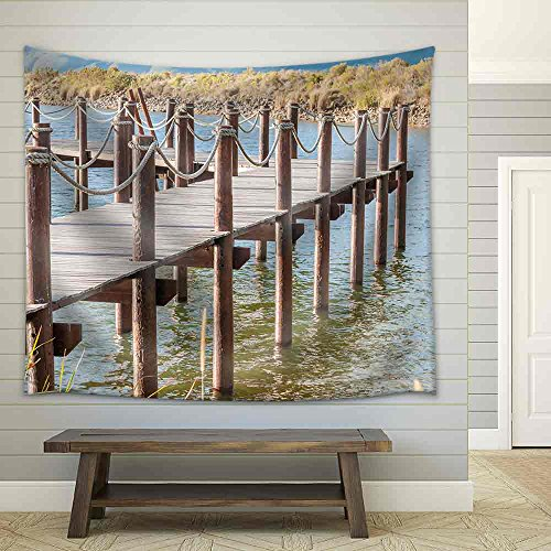 Repeating Pattern of Wooden Poles in a Jetty in a Dam near Sir Lowrys Pass Fabric Wall Tapestry