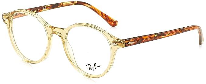 Gafas transparentes Ray-Ban con montura dorada y patillas en color madera.