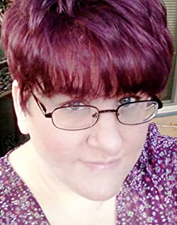 E. Catherine Tobler looks at the camera as if she has a secret; her purple hair matches her purple shirt.