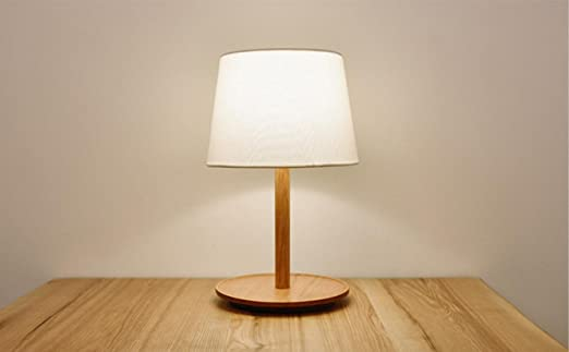 lámparas de lectura simple de madera de cerezo junto a la cama de ...