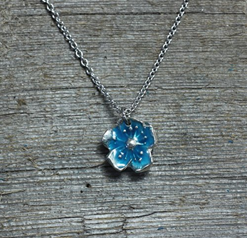 - Flower blossom pendant necklace with blue glow in the dark