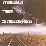 : STEEL RAILS UNDER THUNDERING SKYS