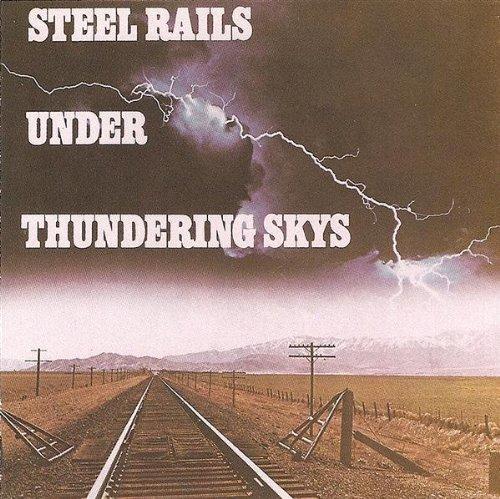 STEEL RAILS UNDER THUNDERING SKYS