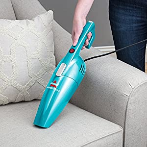 Bissell Featherweight Stick Bagless Vacuum - in use handheld couch