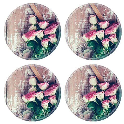 Old Fashioned Rose Bouquet (Luxlady Round Coasters IMAGE ID 31211338 Bouquet of pink roses and a wooden frame on old board background vintage color)