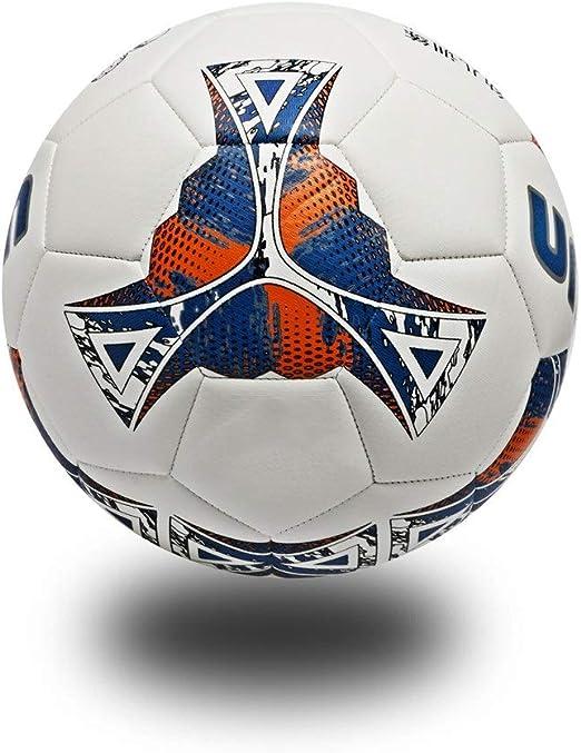 Los niños practican la pelota de fútbol Deporte al aire libre ...
